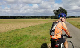 Countryside scene with cyclist Brian in foreground